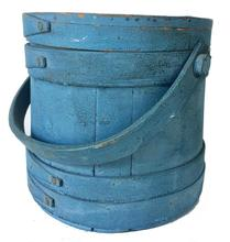 "RM1029  Early to mid 19th century, Firkin, New England origin, Beautiful Original blue painted surface, with nice wear. A great collectible bucket. Fingers laps have copper tacks no staples used in this Firkin . . Measures 9� top diameter 9"" tall 9 1/2� across the bottom"