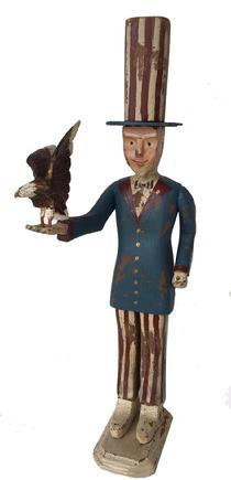 "E267 Patoric Uncle Sam, holding an American Eagle, with a tall stove pipe hat, wooden hand carved, a great piece of American Folk Art, 20th century,  21"" taqll x 7 1/2"" deep x 8"" wide"