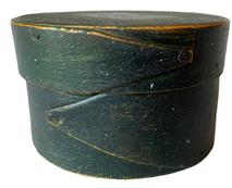 "RM1081  Very early Massachussets Miniature round finger- lapped pantry box in beautiful Windsor green paint.  The wood is Maple with a Pine top and bottom.  This style pantry box with opposing lapped fingers is attributed to the ""Harvard Shaker"" style as seen in the Harvard, Massachusetts Shaker Community of the 19th Century. This size was usually used for medicines/pills.  Measurements:  3"" diameter x 1 7/8"" tall"