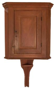 E579 Late 18th century Lancaster County Pennsylvania Hanging Corner Cupboard, with an extending tail with shelf, original salmon paint, circa 1780 - 1810