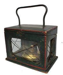 C9 19th century wonderful Lantern with beautiful  decorated Windsor green paint . Very unusual Lantern found in Pennsylvania, with window lights on three sides, with old wavie glass,with metal rods to prospect the old wave glass.  The   back of the Lantern has a door that opens so the burner can be removed, Molded edge around the glass. The top of the Lantern open, to the venting system, with a heavy iron handle for caring, Burner is marked, made in USA Measurements are  8 1/2� wide x 5 1/2� deep x 10� tall