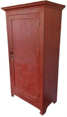 S236 19th century Pennsylvania (Berk's County) one door Storage Cupboard , circa 1820 1840 beautiful red paint, single raised panel door, dovetailed case, applied cove molding,