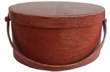 "Z403 19th century  bentwood bail handle pantry Box . New England, Massachusetts, Lapped seams and bentwood swing handles. wonderful old  Original  red painted surface.  7.5""high. 15""diameter"