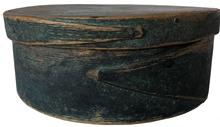 "F27 19th century Small Dark Green -painted Lapped-seam Covered Box, America, round form with pine top and bottom and bent maple sides joined with opposing lapped fingers, measurements are 7"" x 2 3/4"" tall"