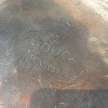A486   Pewter plate or charger, The rim is rolled  The surface has a nice patina, The bottom has the  mark, London measurements are 10� diameter