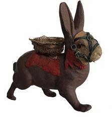 E82  Wonderful  Rabbit candy container made of paper mache� composite / chalkware material.  Rabbit is unmarked but probably German...circa 1930-1940�s.  Rabbit has a removable head and glass eyes and is adorned with an ornate bridle with tiny metal buckles, felt trim, a felt blanket and a basket that is made of what appears to be gold painted loofah. The paper �connector� which secures the head to the body retains its original wallpaper decoration.  Measurements: 6� long and 5 1/2� tall.