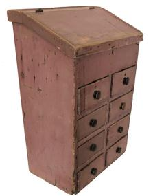 "E53 19th century New England Country Store Apothecary/ / table top Desk, with a lift lid over  eight drawers, in the original dry salmon paint, nail construction with square head nails, the wood is white pine circa 1850 Measurements are: 21 1/4"" X 31"" tall x 13"" deep"
