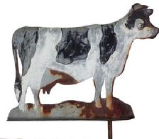 RM132 Early 20th Century Folk Art Cow weathervane, removed from a grain silo in Gap Pennsylvania . Paint is worn due to years of use and there are some rust spots, but it displays beautifully. Great folk art piece.