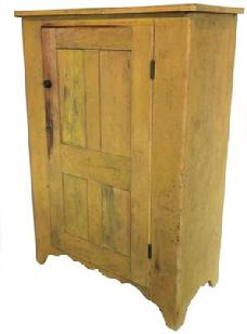 "F41 19th century one door Storage Cupboard from Lancaster County Pennsylvania, beautiful early yellow paint, the door is four panels that is full mortised and pegged, with a high cut out foot, all natural patina on the inside circa 18 20.  Measurements are 18 1/2"" deep x 38"" wide x 54 1/4"" tall"