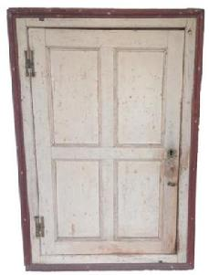 O189 18th century New England hanging corner cupboard with original oyster white and red paint. Circa 1780 Very unusual interior with butterfly shelves and a drawer below. The door is full mortised and pegged construction with brass � H � hinges.