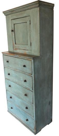 "E307 STEPBACK CUPBOARDOVER DRAWERS .  Mid 19th century, pine. One piece with door above five dovetailed drawers, Top has interior shelf, molded cornice. Old distressed blue paint. Square nail construction. 75.5""high . 35""wide. 16.5""deep."