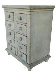 "C446 19th century New England  ten drawer Apothecary, with beautiful old oyster gray paint, resting on four gracefully turned feet, applied molding around the top as well as the bottom. Square head nail construction , the wood is white pine, circa 1850 Measurements are: 15 1/2"" wide x 10"" deep x 20"" tall"