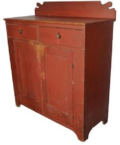 C561 Early 19th century Pennsylvania pine Jelly Cupboard, in original dry red paint, two dovetailed drawers , over two panel doors, with a nice high cut out foot. All square nail construction. The interior is all natural patina
