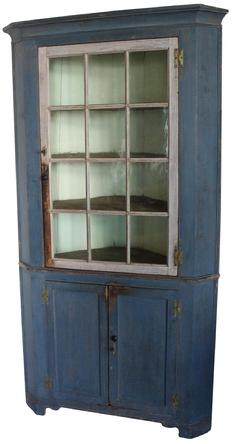 C373 18th century Lancaster County Pennsylvania small Corner Cupboard  (circa 1770) with the original blue and white paint , one twelve pane door, beautiful wave glass, over two panel doors, with original H hinges, ogee pictures frame molding around the case, resting on a small bracket base,