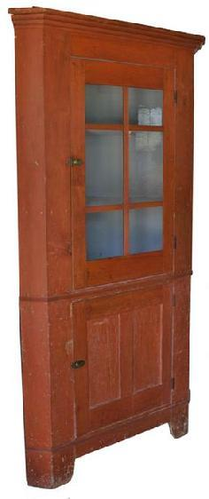 C211 19th century Pennsylvania six pane Corner Cupboard, with the original red paint, with old blue gray interior. High cut out base, with a waist molding. the wood is all white pine, circa