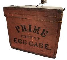 "E440 19th century Egg carring box in original red paint and black stenciling holding 5 dozen eggs - stenciled ""PRIME PATENT EGG CASE"" on left side - original bail pull stamped Patented July 29, 1884"