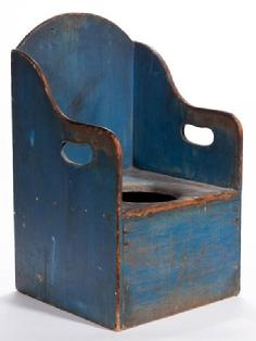 "E23119th century  NEW ENGLAND PAINTED CHILD'S POTTY CHAIR,in the original dry blue paint  with cut-outs on the sides. Measurements are .  24 1/2"" High , 14"" Wide, 13 3/4"" Deep"