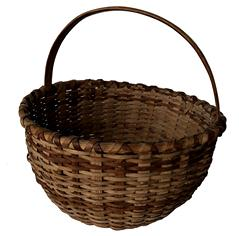 "E36  Gathering Basket, with a steamed and bent handle double wrapped rim, reinforced bottom, really good condition, in natural patin, 12"" wide x 12"" tall"