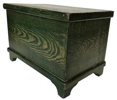 E470 Antique American Green Grain Painted Miniature Blanket Chest Original 19th century Rare green grained painted blanket chest from Lancaster County, Pennsylvania. This pine and poplar blanket chest has the original applied feet and all original hardware. Miniature blanket chests are highly desirable, and good honest ones are getting very difficult to find. The condition is pristine with minor scratches consistent with age and use. This is a great addition to any Folk Art or Americana collection. Circa 1870 measurements 10 3/4� wide 7 1/4� tall 6 1/2� deep