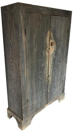 Z950 Mid 19th century Eastern Shore Maryland Two door flat wall Cupboard in the original dry pewter gray paint. The interior has the original dry salmon paint, yellow pine and poplar wood square head nail construction, simple form with a tall applied base. Circa 1860