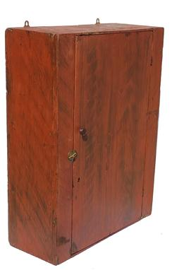 E555 Early 19th Century Hanging Cupboard, paint decorated , Original Surface History found in Maine,  wonderful bold black decoration on a red background.  Circa 1820-1830 measures 31 3/4� tall 24 1/2� wide 10� deep