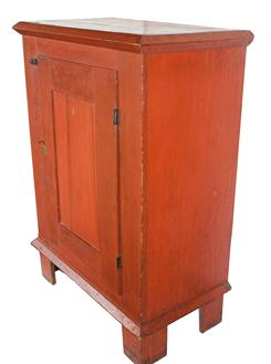B412 Mid 19th century single door Milk Cupboard, with original bittersweet red paint . Applied molding on top held in place with wooden pegs , one board construction , with a single panel door circa 1840 - 1850 l