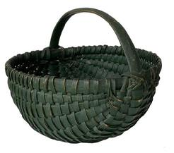 F318 19th century , Melon gathering basket, in original dry green painted surface, woven oak splits on bentwood frame, the handle is hand carved and steamed and bent, heavy construction attributed Shenandoah Valley, Virginia