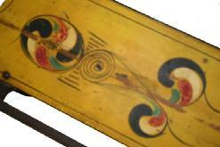 W59 ANTIQUE PAINT DECORATED CHILD�S SLED. red and blue, yellow paint decorated top, Wrought iron runners. some wear to the paint