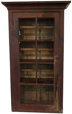 D267 18th century Lancaster Co. Pennslyvania red painted Hanging Cupboard with an eight window lites door, the interior of the cupboard is painted mustard with removeable plate rails and plate groves in the shelves with spoon rack shelves, dovetailed case,