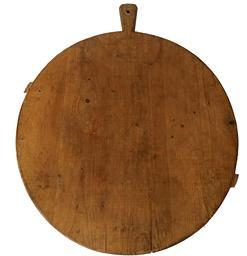 F238 19th century wooden Peel Board/ cutting board . The runners you see showing actually was the bottom of the peel board but for display it looks more interesting with the runners showing. The other side is perfectly flat for working on . The patina is wonderful, from years of use.