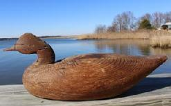"Y139 Early wooden Goose Decoy with wonderful weather surface, attributed to a Long Island ,New York area  , branded on the bottom, circa 1920's  measures 23"" long x 9"" tall"
