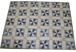 1W58 Hand made Quilt filled with ungined cotton, and made from feed sacks. Star pattern,  this quilt is not quilted it is held together with  tied  knots, found in Virginia, possible   (African American)