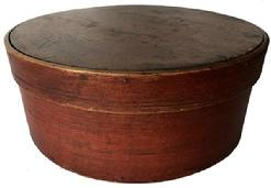 "D514 19th century New England  Pantry Box with beautiful red paint  ca. 1880; bentwood box with tack bands, dark red exterior  natural patina on the inside   11"" diameter x 4 1/2"" tall"