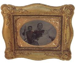 RM221 Mid 19th century Civil War Era very nice Family image, with small Boy holding the American Flag. In one of a kind gutta-purchase frame circa 1860