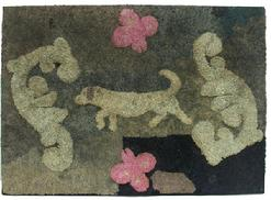 "Y96 Hooked Rug found in Maryland, early 20th century, mixed fabrics on burlap. Waldoboro-style raised design of a long bodied dog on point, surrounded by abstract motifs and pink butterflies. Mounted on a stretcher, 27""h. 39""w."