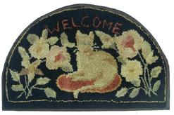 "X407 HALF ROUND ""WELCOME"" CAT HOOKED RUG. Beautiful  rug is well designed, useing the colors  black background with whites and salmon, touch of geen, choice colors that  compliment it's appearance. it's been mounted and ready to hang. Dating from the 1920s, it measures 34"" long x 22"" wide"