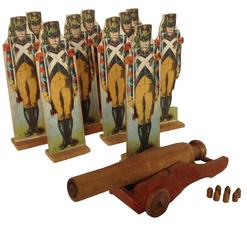 "A465 Late 19th century  10  Vintage toy Soldiers, with a working toy cannon Measurements are : 10"" tall x 3"" wide"