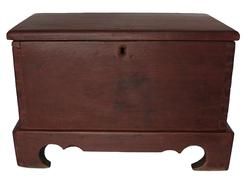 B375 Early 19th century Eastern Shore Virginia Miniature Blanket Chest,the wood is walnut  with the original red paint, vey unusual applied cut out design base, dovetailed case,  circa 1820 - 1840