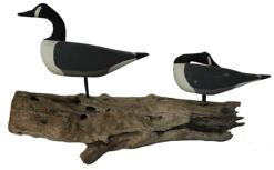 "B461 Hand carved wooden Geese, one in sleeping position, all original maker unknown mounted on driftwood  15"" long x 8"" tall"