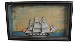 C207 Early 19th century diorama of the three masted black and white  ship, flying a 30 star american  (1848) in full sail in a blue sea of white-capped grey waves,blue skies with billowing white clouds in the back ground. In original wooden framed shadow box with old wavie glass .