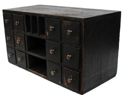 "C343  19th century country store counter top 12 drawer  Apothecary with cuby holds, in old black painted surface, wire nail construction circa 1880 Measurements are: 20"" wide x 11"" tall x 9 1/2"" deep"