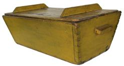 C55 19th century Pennsylvania table top Dough Box in vivant yellow paint, dovetailed case with canted sides, applied handles all original
