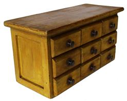 D145 Late 19th century nine drawer  spiece Chest in the original mustard paint, nail construction with brass knobs, circa 1870