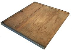 "D439  19th century Noodle Board or Dough Board, with three sided gallery, dark blue paint, early square head cut nails the gallery keep the dough on the work surface. The wood is pine, with original dry unclean surface Measures 25 1/4 "" wide x 21 1/2"" deep"