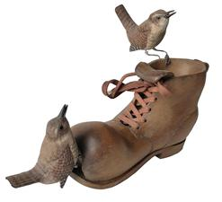 E192 Great piece of American Folk Art, with a hand carved work boot, with two birds resting on it. with exception of the shoe lace, it is all wood, sign on the bottom Jay V.Irwin 1985. Jay V. Irwin died in 2014 his  love of nature led him to his post-retirement career as a woodcarver. Two of Jay's carvings made their way to the White House. One was given as a gift to President Jimmy Carter and one was on the 2002 White House Christmas tree at the request of Laura Bush.