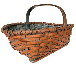 E549 19th Century Pennsylvania gathering basket retaining it's wonderful original dry pumpkin -paint, steamed - bent and notched handle, double wrapped rim with reinforced bottom.
