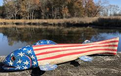 E529 PATRIOTIC FLAG FISH DECOY FOLK ART PATRIOTIC Fish  Decoy is  hand carved  the metal fins and line ties  actually guide the decoy through the water decoy is approximately 12�