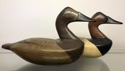 "E298 Miniature pair  high head canvasback Decoys in ( Charles Barnard style) sign and dated on the bottom Dr  Lipman ? Baltimore Md.  2005 7"" long x 5"" tall"