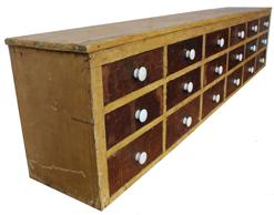 "MM119th century Pennslyvania Country Store Apothecary with 18 dovetailed drawers, original proeclain knobs, mustard  painted case with old surface drawers. This apothecary was made to set on a counter top , Measurements are 80"" long x 12"" deep x 18"" tall"