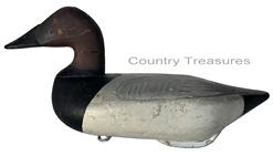 RM1051 Early Bob McGaw Canvasback Drake decoy. Paint is a second coat of working paint, also done by McGaw. Original �dog bone� weight and iron ring on bottom. Measures approximately 16� long x 6 3/4� wide x 7 1/2� tall